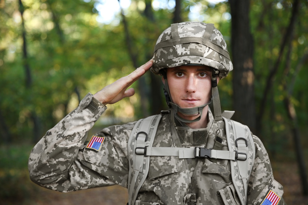 Soldier in camouflage taking salute