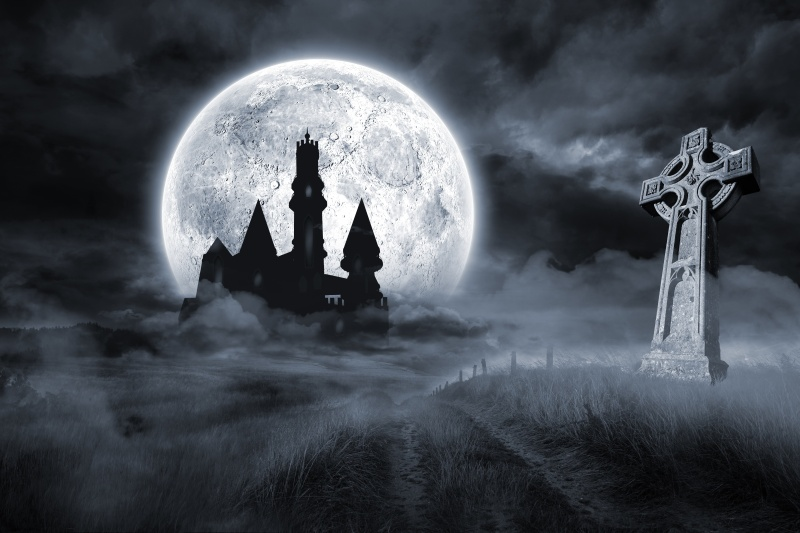 Castle and grave under full moon